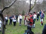 Apple wassailers gather around one of the older apple trees in the orchard