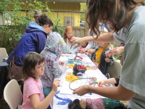Kids and their parents alike enjoyed making dream weavers, facilitated by artist David Francis.